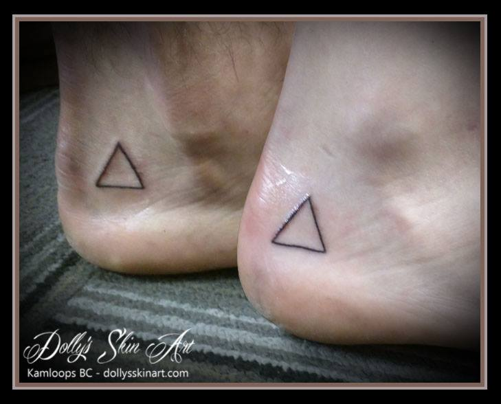 small black matching line triangle foot feel tattoo kamloops dolly's skin art