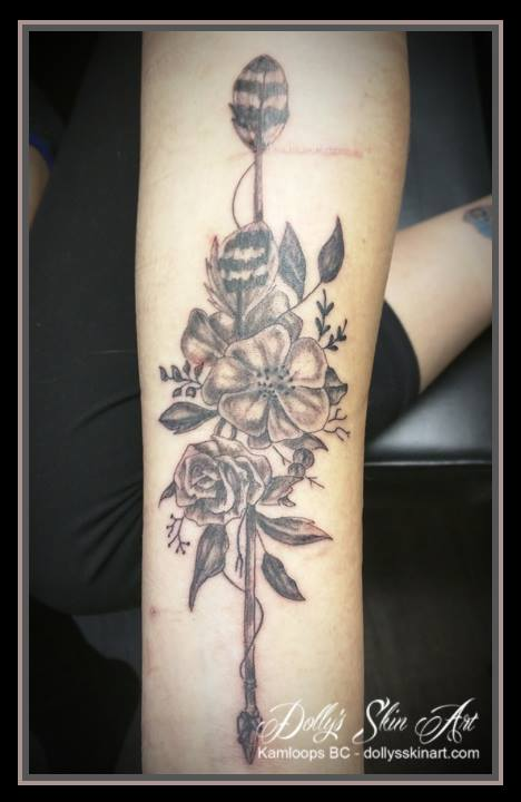 black and grey shading flowers wooden arrow arm tattoo kamloops dolly's skin art