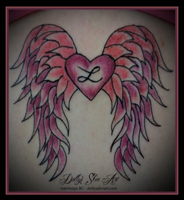 small simple pink wings heart sternum colour tattoo