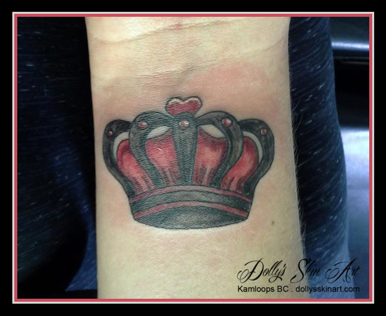 red black crown wrist tattoo