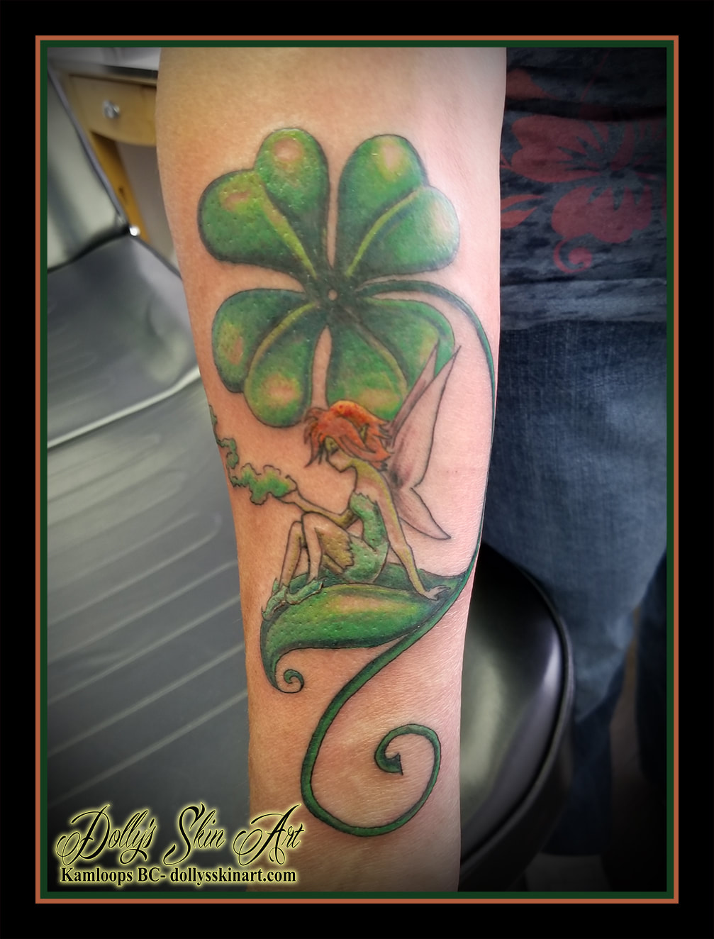 irish cartoon fairy girl sit on leaf clover smoke green orange forearm tattoo kamloops dolly's skin art
