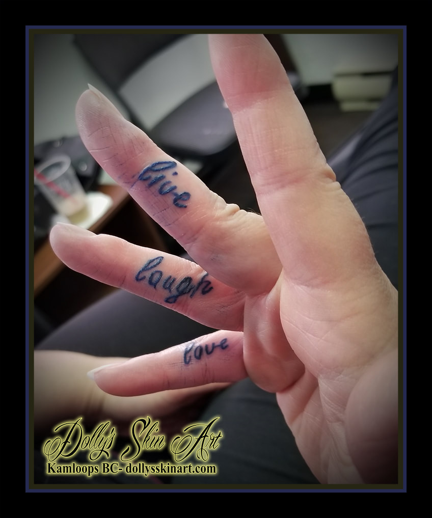 live laugh love blue handwriting script finger hand tattoo kamloops dolly's skin art