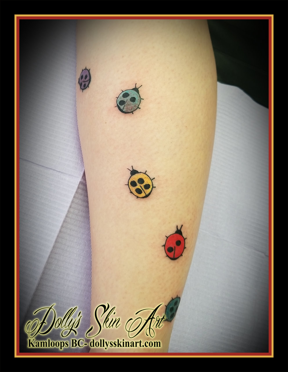 small simple cute ladybug leg tattoo purple green yellow red blue colour kamloops dollys skin art