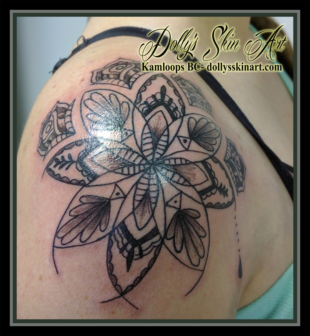 black linework mandala shoulder tattoo kamloops dolly's skin art