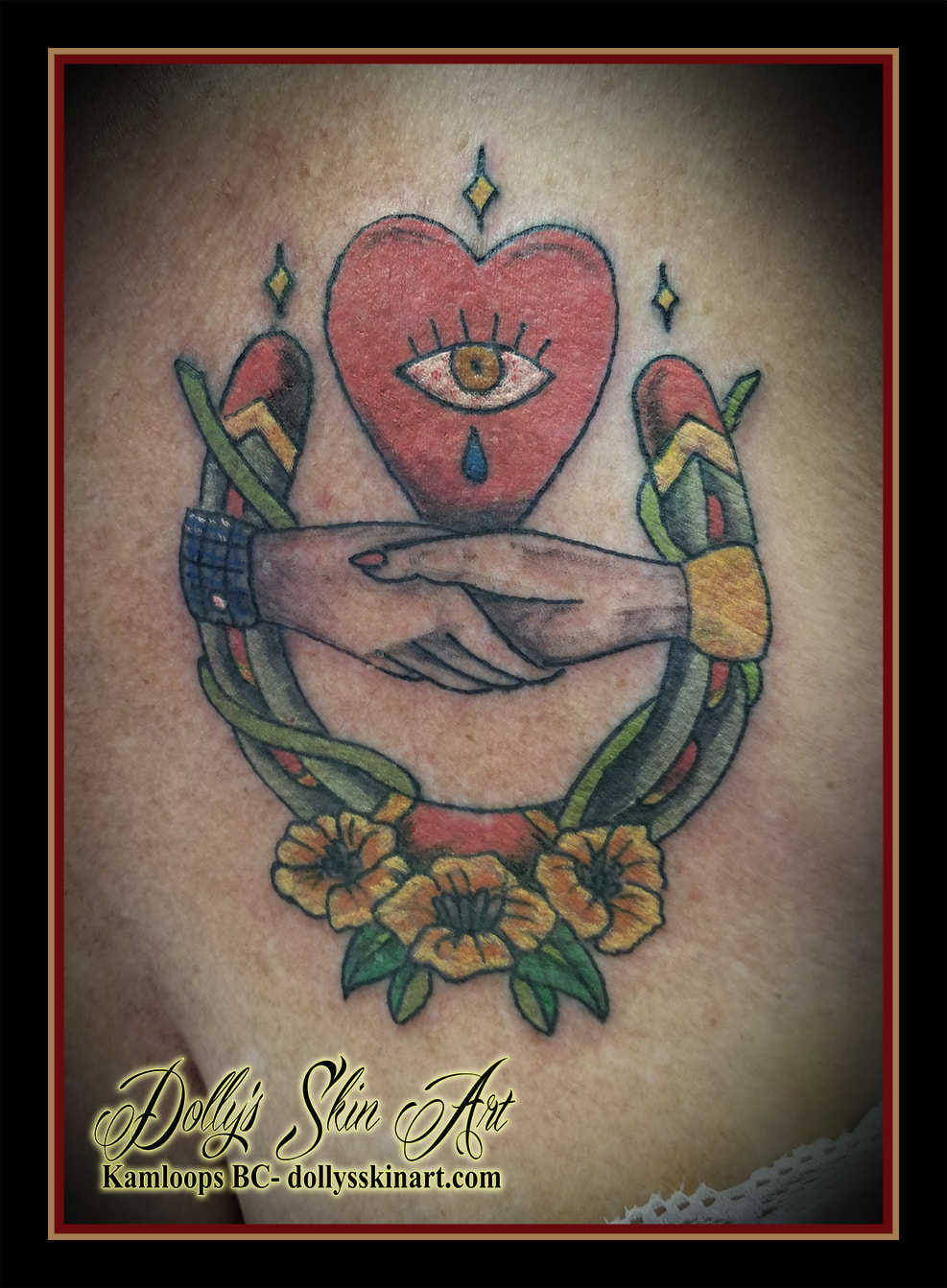 traditional colour horseshoe hands heart eye flowers tattoo kamloops dolly's skin art