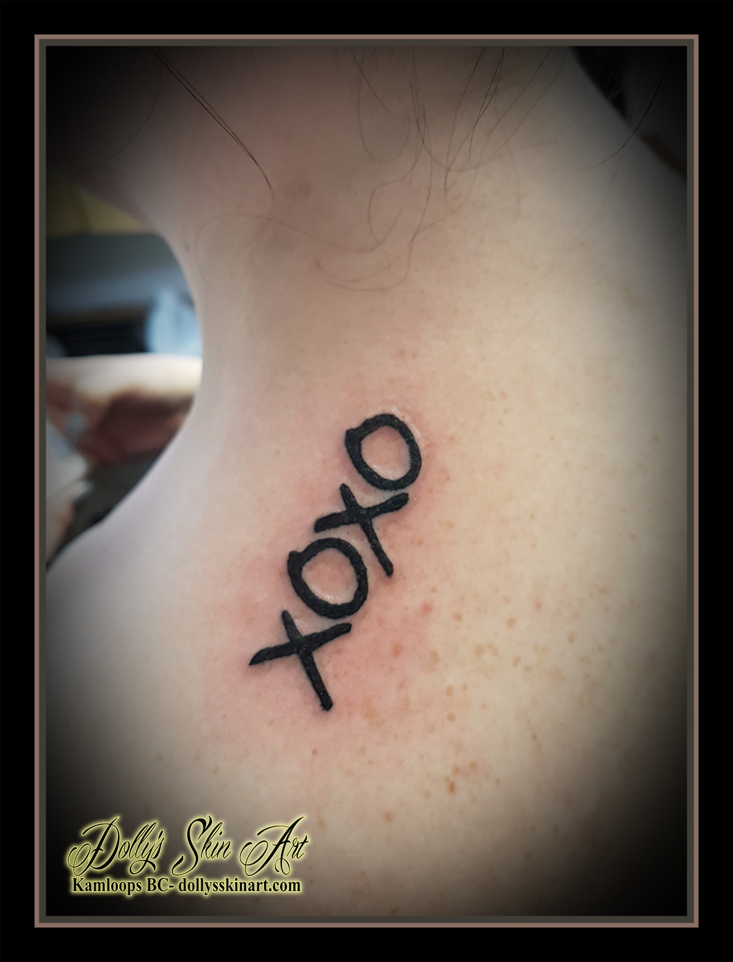 XOXO black lettering font linework shoulder first tattoo kamloops dolly's skin art