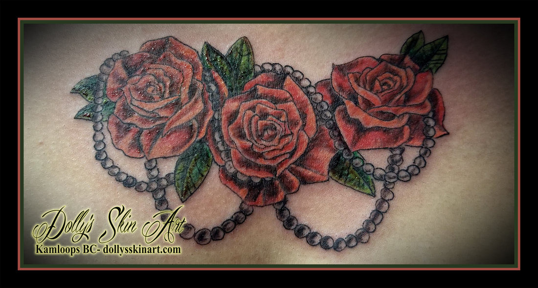 red green roses flowers pearls color small chest tattoo kamloops dolly's skin art