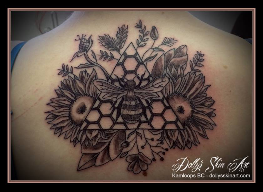bee sunflowers thistle black grey shaded linework honeycomb back tattoo kamloops dolly's skin art