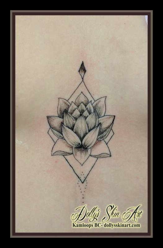 small tiny black lotus single line chest tattoo kamloops dolly's skin art