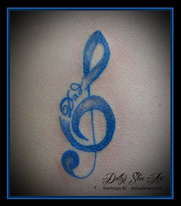 small blue treble clef dad tattoo
