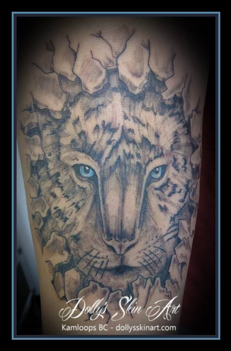 black and grey tiger breaking out of rock blue eye tattoo