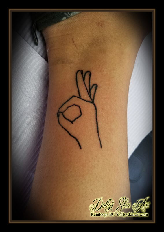 a ok hand symbol outline black work ankle tattoo kamloops tattoo dolly's skin art