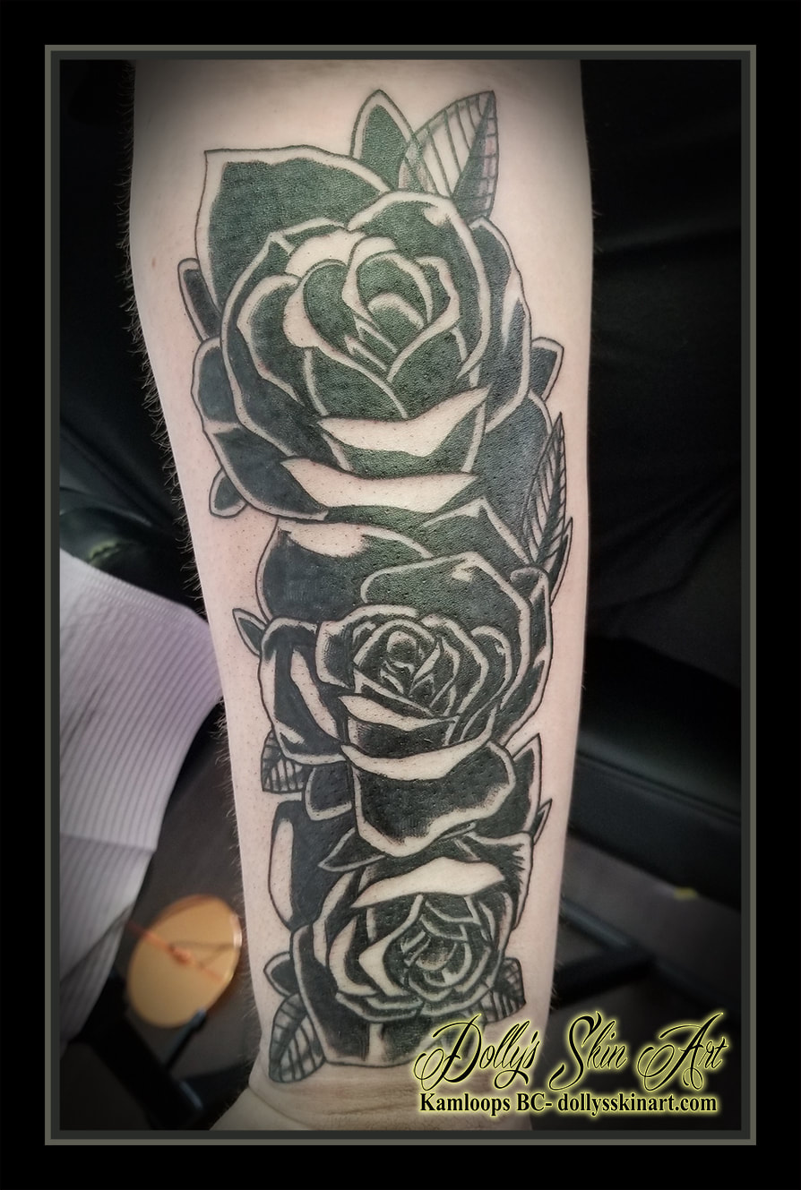 black roses tattoo silhouette style flowers leaves forearm tattoo kamloops dolly's skin art