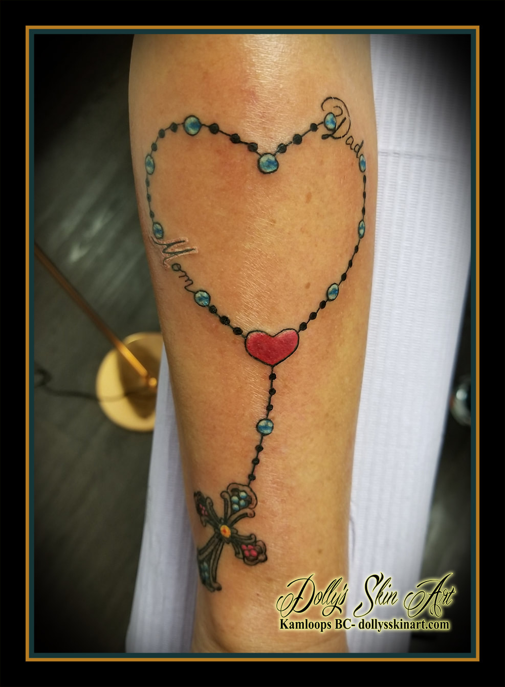 rosary colour heart forearm beads cross yellow blue red mom dad tattoo kamloops tattoo dolly's skin art