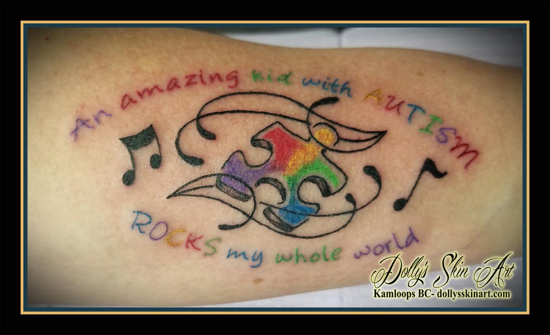 autism puzzle piece colour music lettering font script an amazing kid with autism rocks my whole world tattoo kamloops dolly's skin art