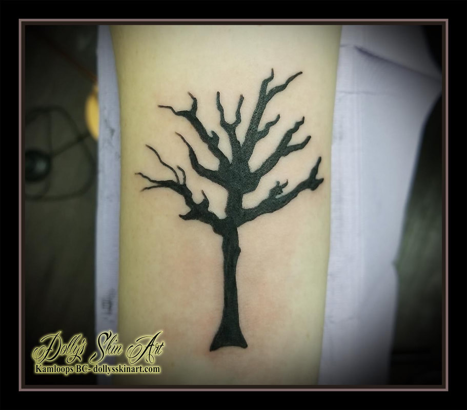 tree black silhouette dead forearm fill in solid tattoo kamloops tattoo dolly's skin art
