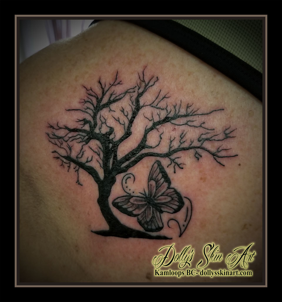 black and grey solid orchard tree butterfly filigree shoulder tattoo kamloops dolly's skin art