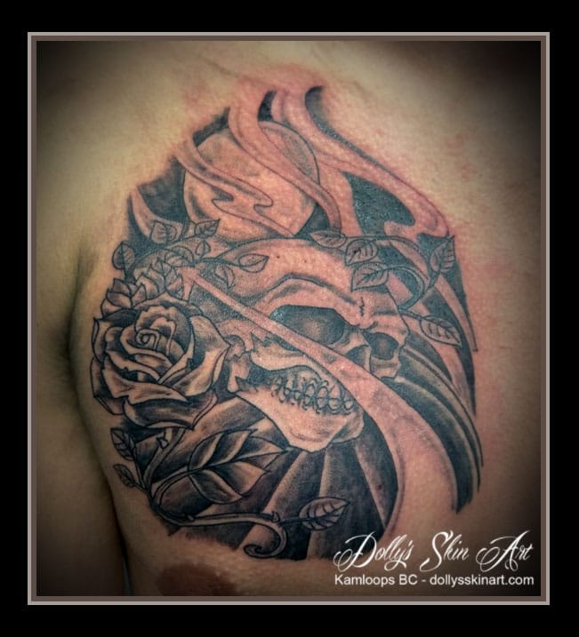 black and grey traditional style skull moon flower rose chest tattoo kamloops dolly's skin art