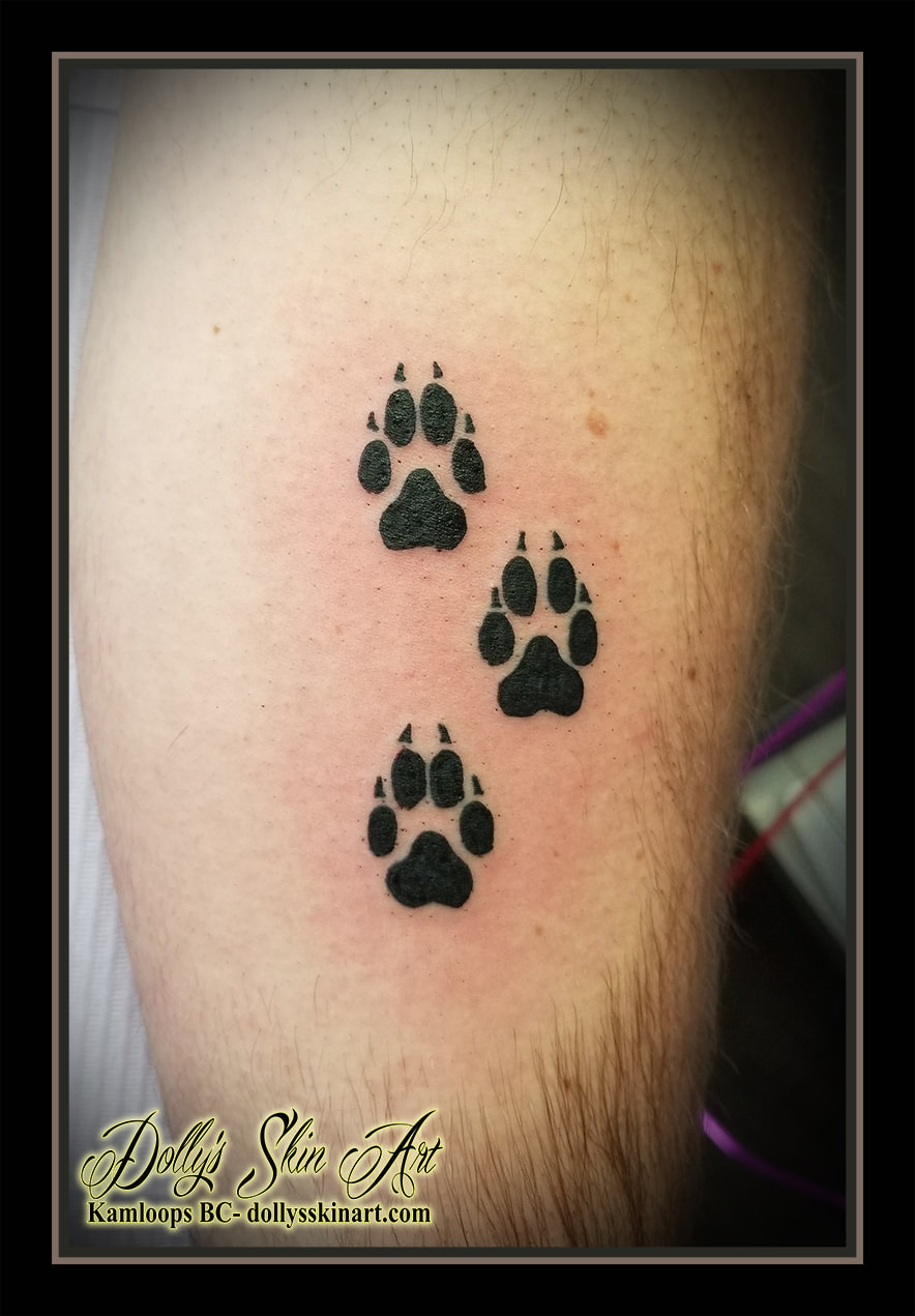 paw prints tattoo pawprints black solid silhouette tattoo kamloops dolly's skin art