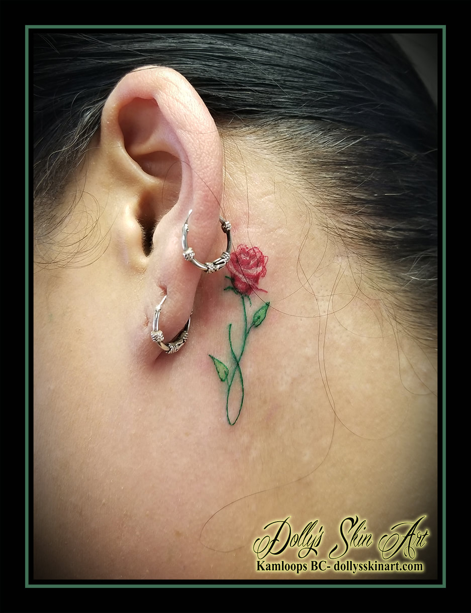 red rose tattoo infinity behind ear red white green stem leaf flower tiny small tattoo kamloops dolly's skin art