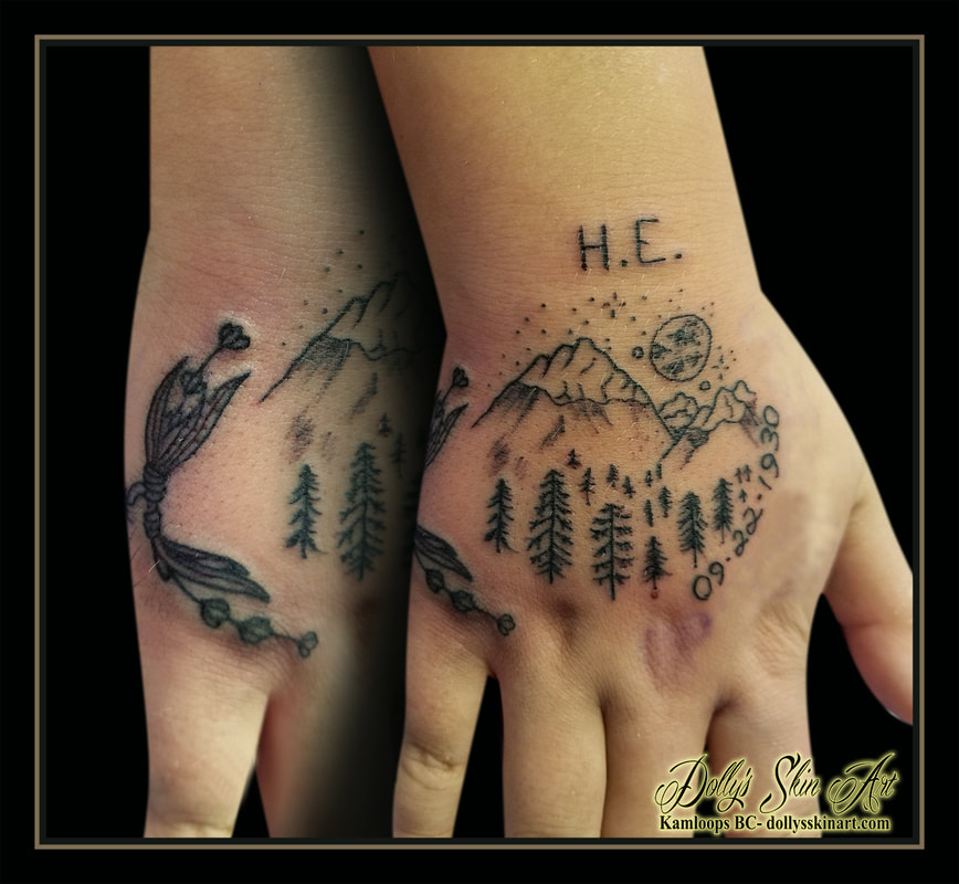wilderness hand tattoo black memorial trees mountains moon flowers initials date numbers tattoo kamloops dolly's skin art
