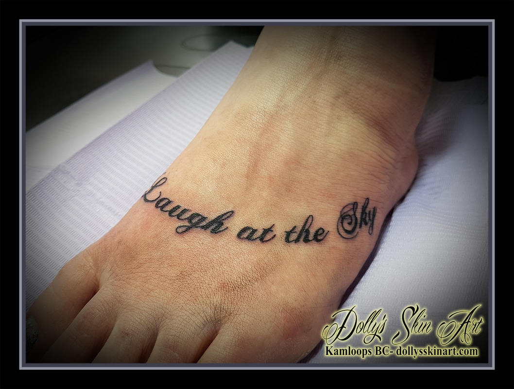 laugh at the sky foot tattoo font lettering black kamloops dolly's skin art