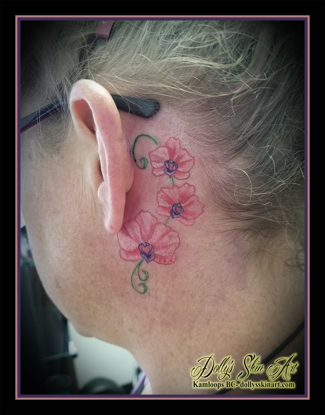 orchid flower small behind ear three orchids pink green purple white shaded colour tattoo kamloops tattoo dolly's skin art