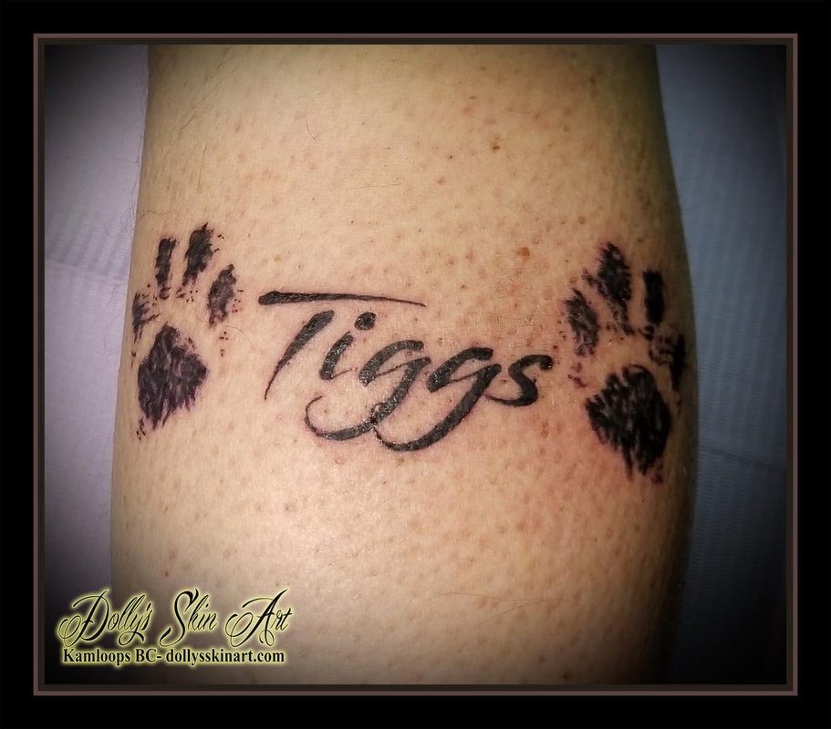 cat paw prints black and grey ink tiggs memorial lettering script font tattoo kamloops tattoo dolly's skin art