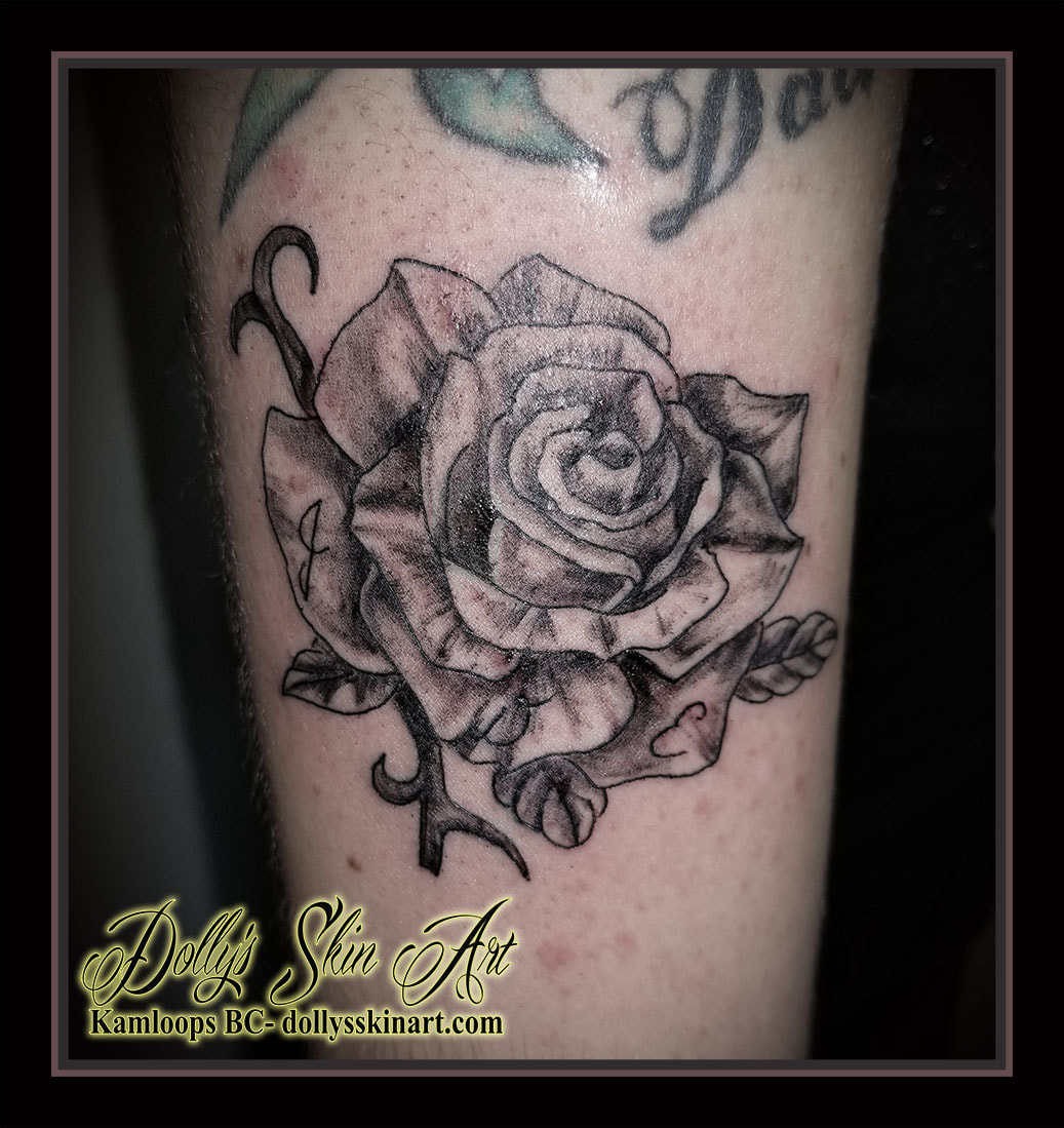 black and grey shaded rose small initials j d e tattoo kamloops dolly's skin art
