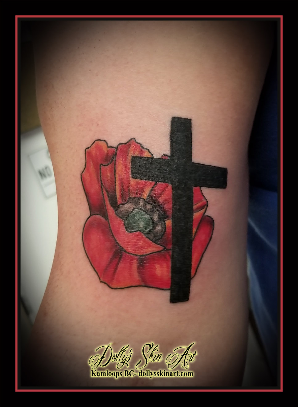 poppy cross tattoo red black grey shading arm tattoo kamloops dolly's skin art