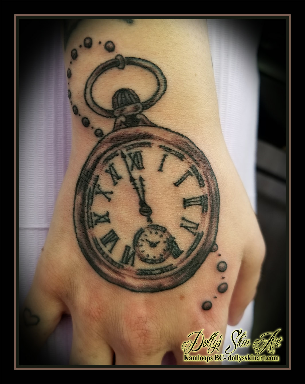 pocket watch tattoo hand black and grey shading clock tattoo kamloops dolly's skin art