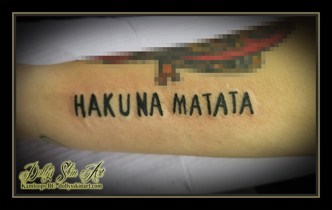 hakuna matata tattoo swahili disney lion king lettering font script blackwork forearm matching there are no troubles tattoo kamloops dolly's skin art