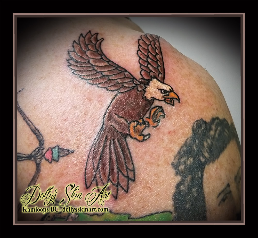 traditional eagle color tattoo colour brown black white yellow shoulder flying attack tattoo kamloops dolly's skin art